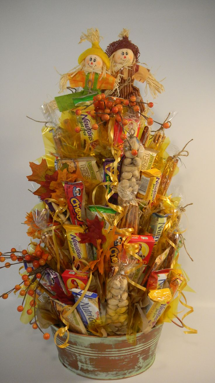 "The Fall STACK OF SNACKS from THE SNACK BASKET is loaded with Pistachio Nuts, Pretzels, Nutragrain Bars, Raisons, Quaker Chewy Bars and Fig newtons!  Over 2 feet high and filled all around!          .... ""What's in it for you?"""