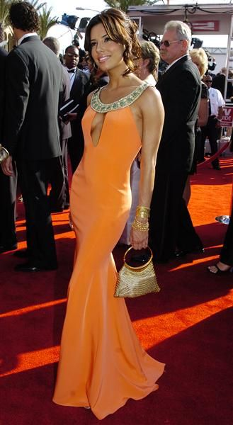 "With one season as Gabrielle Solis on ""Desperate Housewives"" under her belt, Eva Longoria hit the 57th annual Primetime Emmy Awards on Sept. 18, 2005, where she sizzled in a coral Angel Sanchez gown with a seductive keyhole detail.RELATED: Angelina Jolie's changing looks"