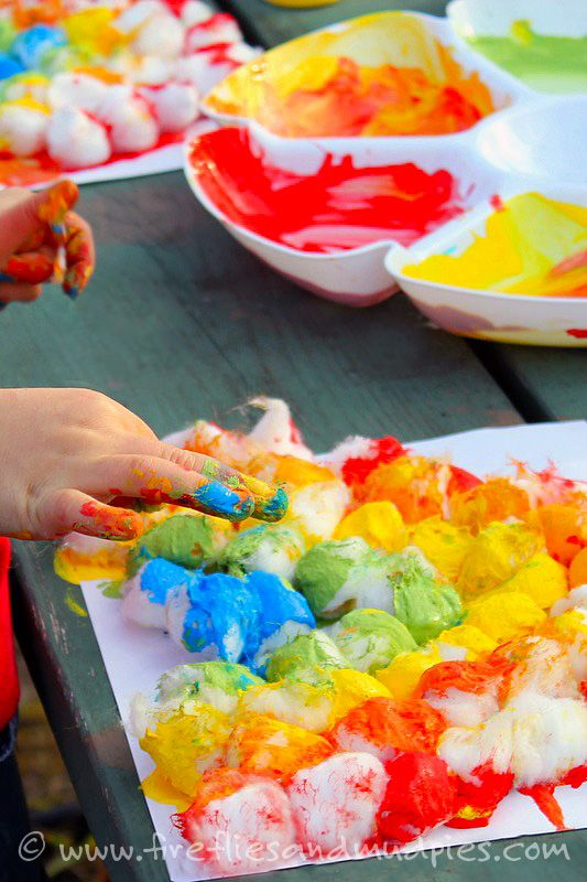 Kids will love this messy, vibrant cotton ball rainbow craft!