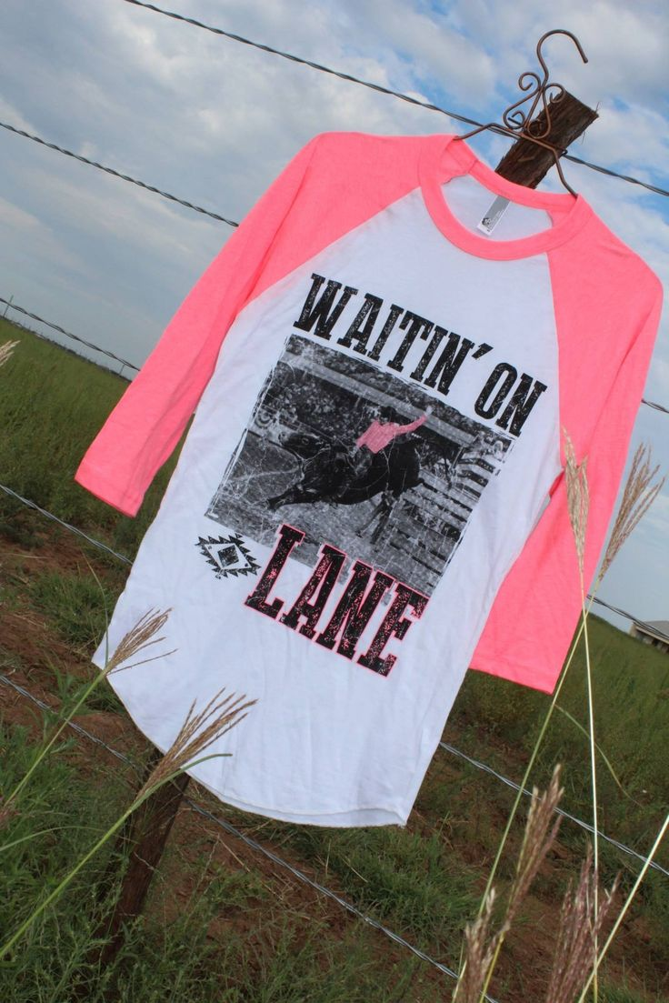 Neon pink baseball tee with a scene from the famous movie 8 Seconds. LANE FROST!