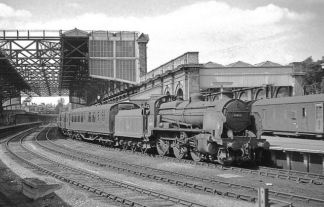 In summer 1963 an old Maunsell 'N' class loco waits at Bournemouth Central with a local service to Eastleigh. Hampshire (now Dorset), England.