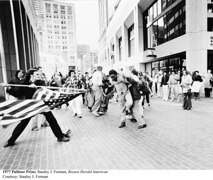 The Soiling of Old Glory - April 5, 1976 - Protesters of desegregation busing in Boston attack lawyer and activist Ted Landsmark - by Stanley Forman