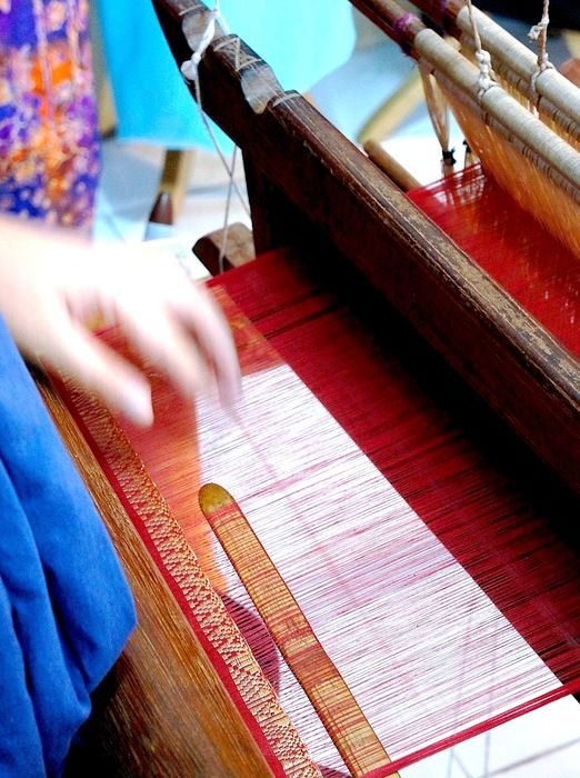 "Songket weaver: Pandai Sikek is one of the best places to obtain the region's famous hand-woven cloth called ""songket"". There is a street in Pandai Sikek dedicated to stores that sell ""songket"" fabrics. (Photo by Raditya Margi)"