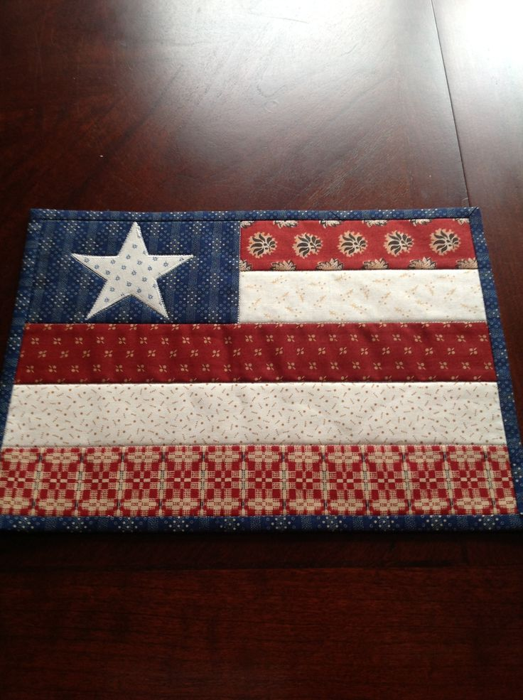 I like to participate in craft swaps and this is something I made for my partner in a recent swap. She loves patriotic things and mug rugs, so I combined the two and this is what I came up with.