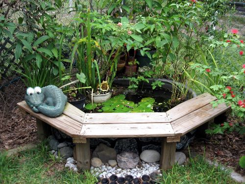 Cool way to finish out an above ground water feature for Diy pond liner ideas