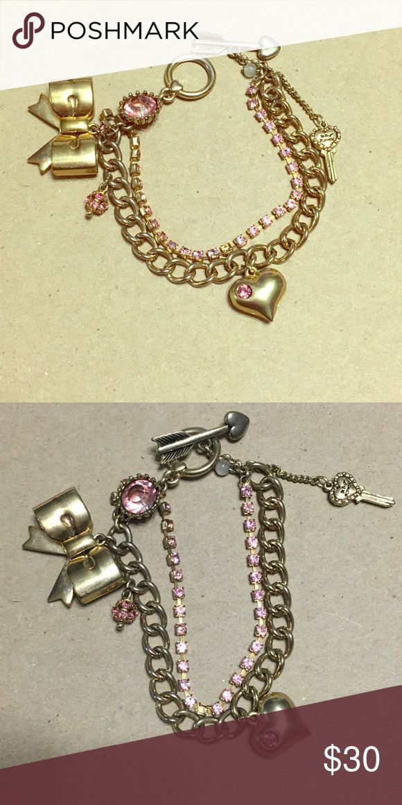 Betsey Johnson charm bracelet Cute gold charm bracelet with bow, heart and arrow toggle and pink rhinestones Betsey Johnson Jewelry Bracelets