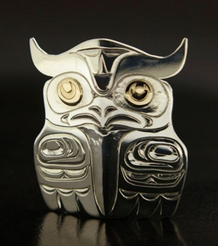 This is a bold and beautiful Owl pendant that has been hand-engraved by an established Northwest Coast Native jeweler. Made from sterling silver, with 14k gold eyes. Measuring 1 5/8 inches high by 1 3/8 inches across, this piece is large enough to catch some eyes but small enough to wear regularly. Within many cultures in the Pacific Northwest, the Owl is a symbol of wisdom and mystery. Nocturnal and stealth, these great hunters demand respect. $560. By Kelvin Thompson.