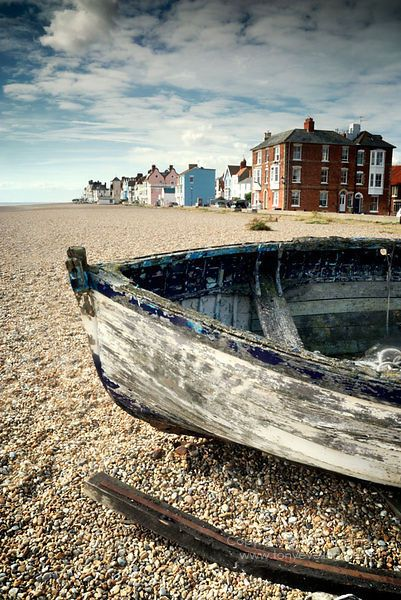 Old boat and shingle beach, Aldeburgh, Suffolk, England,UK