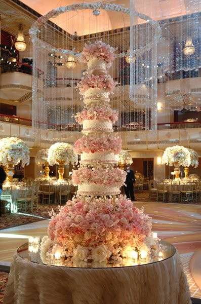 Extravagent expensive wedding cake with live pale pink roses. themarriedapp.com hearted