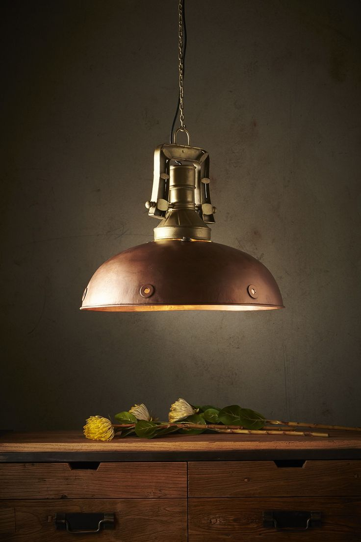 A warm copper dome with portholes along the rim supported by a chunky industrial fitting and chain in brass.  This pendant strikes a perfect balance between its industrial feel, colour and curved form. $545 Zaffero