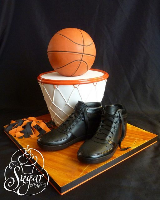 Basketball cake! With converse instead of those dress shoes and it would be perfect for my sis