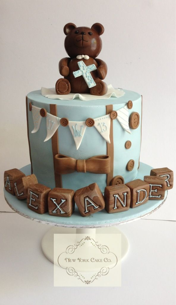 Baby boy christening cake in light blue and brown.