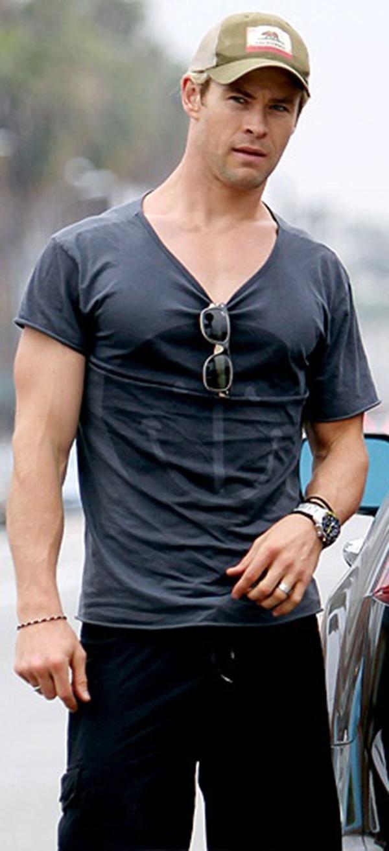 Chris Hemsworth...loving the surfer look.