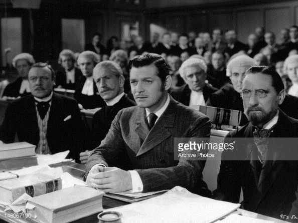 Clark Gable seated in full chamber in a scene from the film 'Parnell' 1937