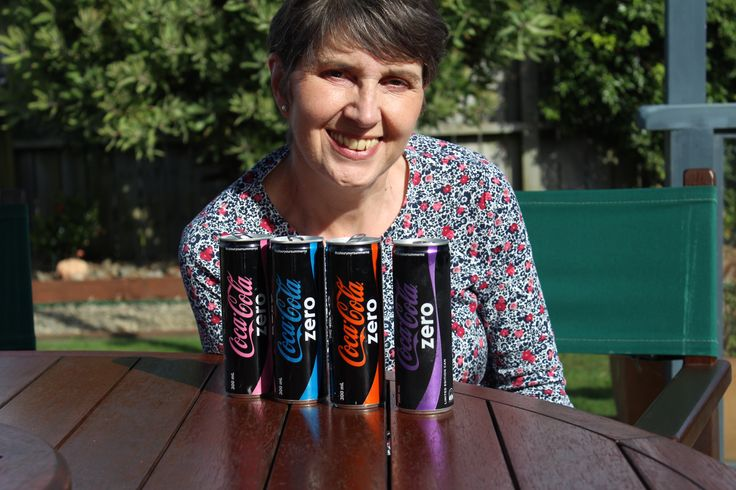 Jayne was impressed with the different colored Coke cans in NZ
