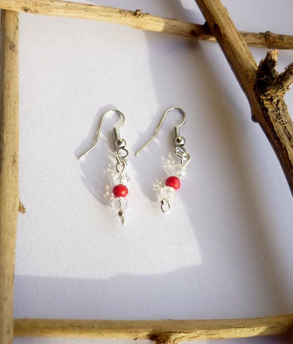 Light coming through the beads of this pair of earrings makes them sparkle and underlines the character of their colour.  Red is energizing, it excites the emotions and motivates us to take action, promoting ambition and determination.  Being the color of physical movement, the color red awakens our physical life force. It is the color of sexuality and can stimulate deeper and more intimate passions in us.