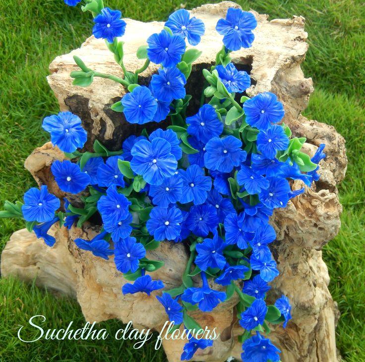 Blue flowers... Hear 206 Leaf,,,60 Flowers..50 Buds.. Handmade clay flowers.. https://www.facebook.com/suchethaclay?ref=hl