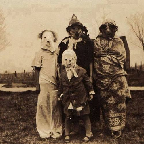 Halloween ca. 1910.  Poor kids couldn't see where they were going.  Good thing the traffic was not a big issue.