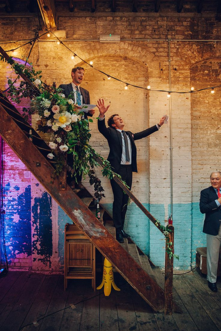 Speeches | Festoon Lights | Flowers |  Brixton East 1871 Contemporary Wedding | Image by Deborah Grace…