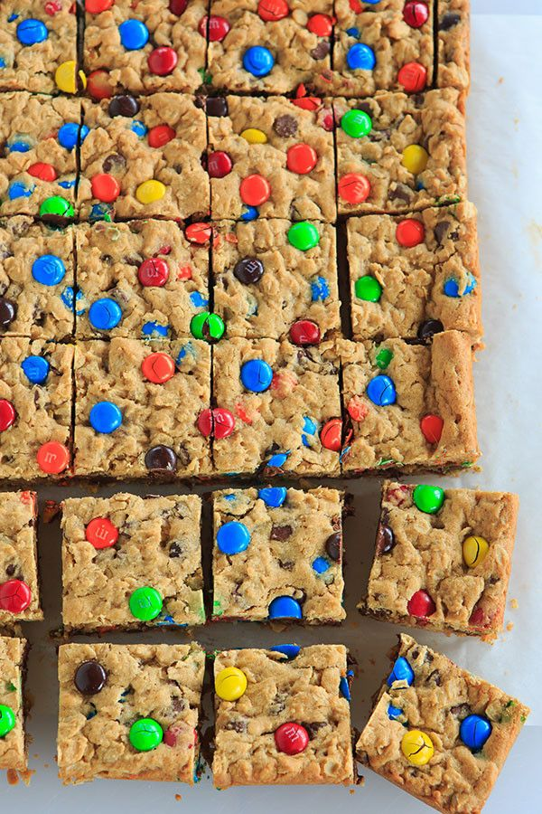 Monster Cookie Bars - Peanut butter dough is loaded with oats, chocolate chips and M&M's. | http://www.browneyedbaker.com/monster-cookie-bars/