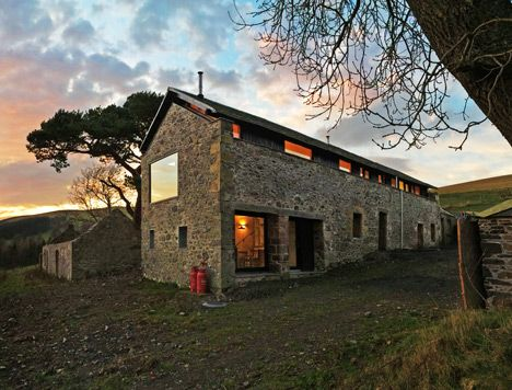 The Mill house by WT Architecture. The blackened timber walls of this family holiday home are hidden within the shell of an old stone mill in the Scottish countryside. The old grain threshing mill forms part of Southside Steading, a collection of disused farm buildings that nestle into a hill overlooking a valley in the Scottish Borders.