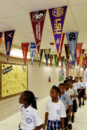 NEW ORLEANS—A more or less orderly line of four-year-olds, the boys in uniform blue polo shorts and the girls in plaid-checked jumpers, line up in the corridor of St. Rita Catholic School in the neighborhood known as Uptown. College banners hang from the ceilings, inspirational passages on the walls, and a sign on the door …