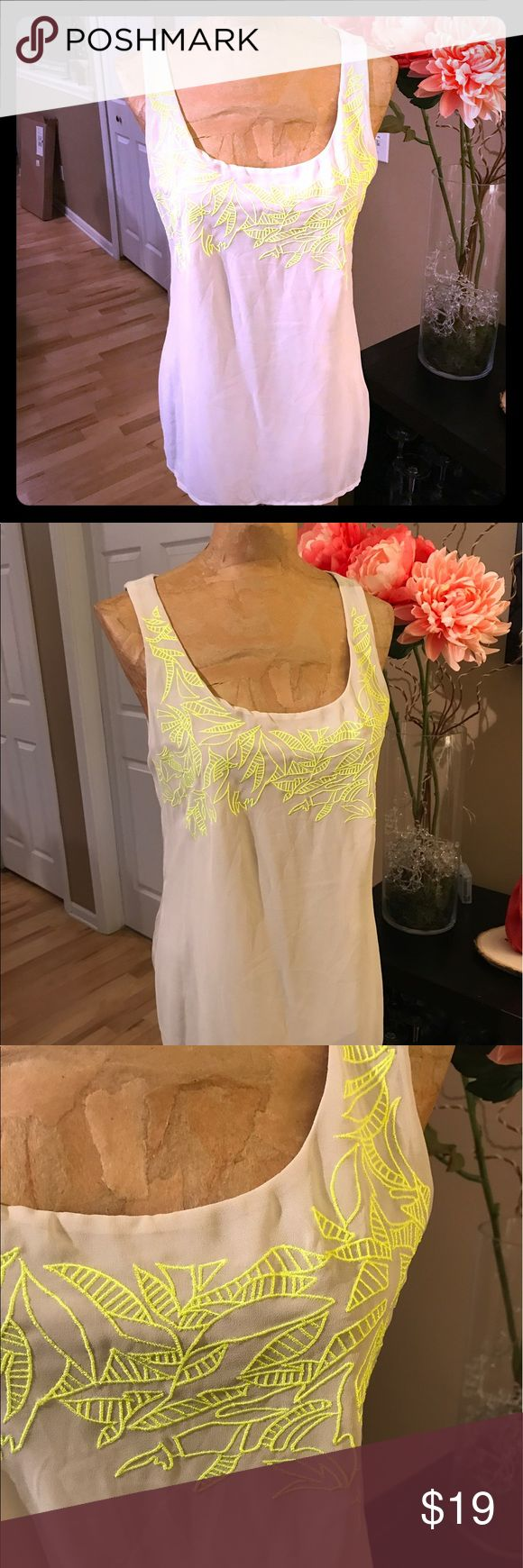 NWT!! Stone and Yellow top Stone/tan top by Express. Neon yellow embroidery on front. Cut out open back. NWT, never worn. Express Tops Tank Tops