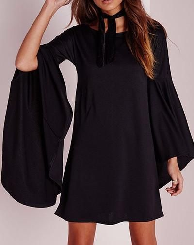 Super cute easy to wear flounce around flare sleeve Dress/Tunic wear with Leaggings in colder weather! Flattering Black and Trendy Deep Green! Cotton-Poly blend