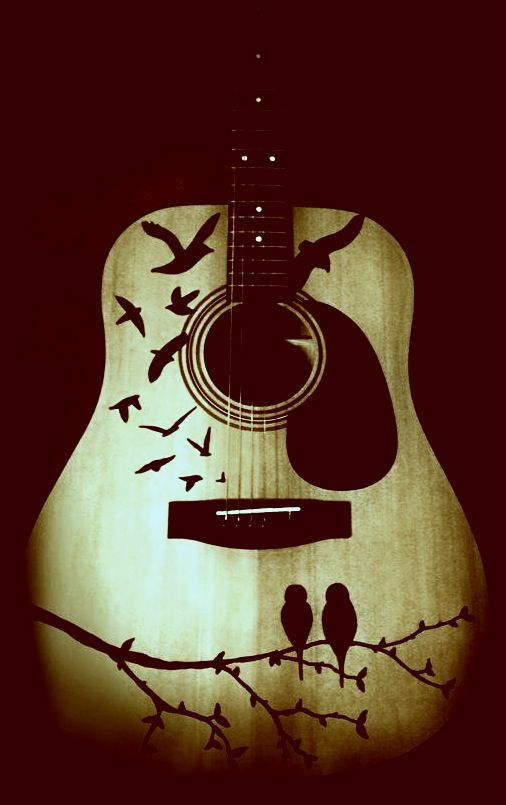 Used one of his guitars as a canvas for Sharpie art. Sounds even better now! ;) -carli moss