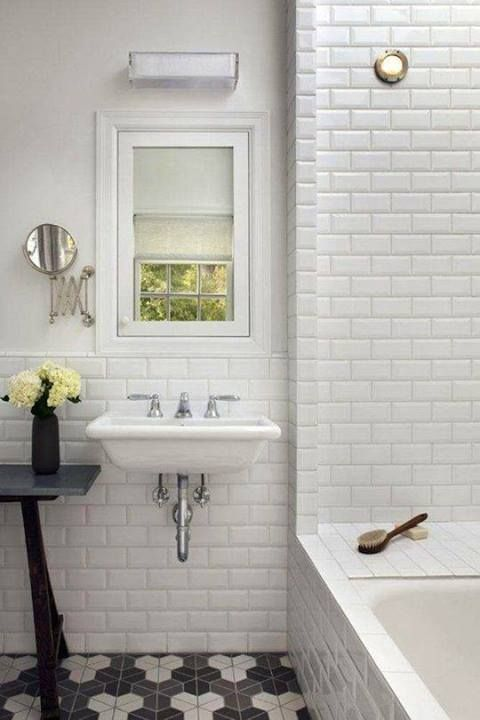 Great bathroom - subway tile walls and unique tiled floor