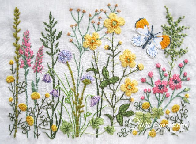 Wildflower embroidery with appliqued butterfly.