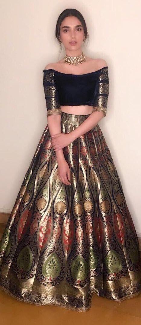 Actress Aditi Rao Hydari in a Benarasi lehenga with a velvet off shoulder blouse designed by Manish Malhotra #aditiraohydari #manishmalhotra #benarasilehenga