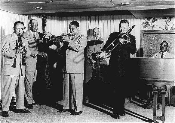 Kid Ory's Creole Orchestra. l to r: Phil Gomez, Wellman Braud, Alvin Alcorn?, Minor Hall, Kid Ory, unknown.