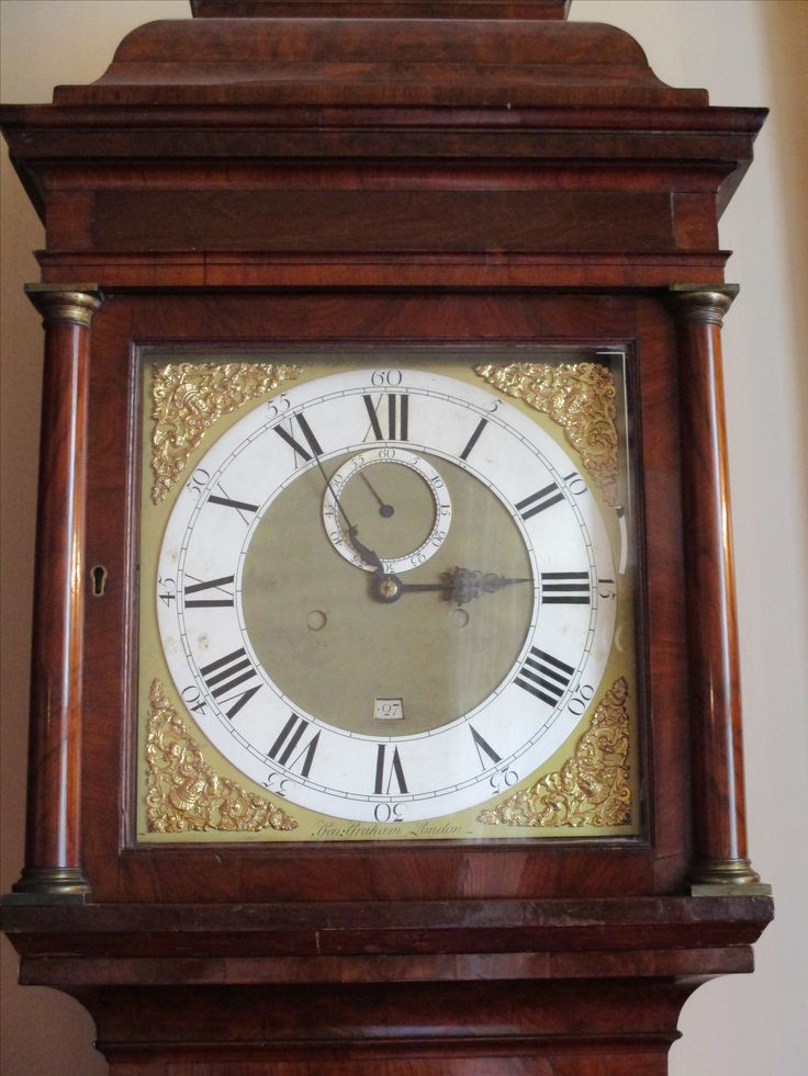 Walnut longcase clock with 12 inch dial.  Incribed, 'George Graham, London' (b.1673, d. 1751).  Case has the trade label 'Wall and Son, Richmond, Surrey'.   Blue steel hands.  Silvered chapter ring for legibility, 8 day movement.  Ante-room to the Blue Drawing Room.
