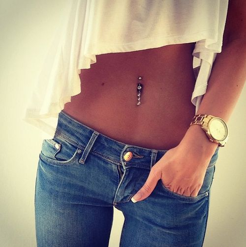Cute shirt and jeans over a belly button piercing!