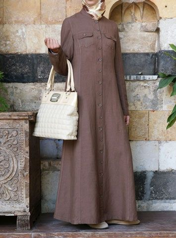 Urban Jilbab Save 38% Hazelnut color  Simple style, natural flair. This jilbab is classic and comfortable. Finished with simple buttons, pockets on the chest, and discreet pockets, this well-crafted jilbab is humble elegance at its best.