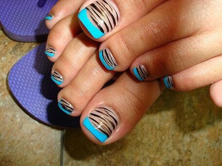 Pretty pedicure: black tiger design over nude polish with turquoise French tips