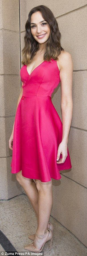 Flirty at 30: The Israeli actress made the most of her petite figure as she slipped into a plunging red skater dress