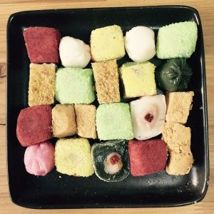 Korean rice cakes arranged on a dish. Ready to be presented to my guests. Which one would you pick?