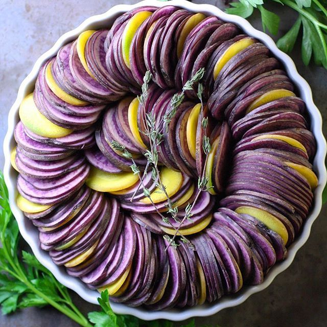 Spiraled Blue Potato And Yellow Carrot Casserole via @feedfeed on https://thefeedfeed.com/urbankitchenapothecary/spiraled-blue-potato-and-yellow-carrot-casserole