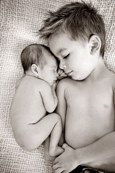 New sibling photo - lots more newborn photo ideas on this site.