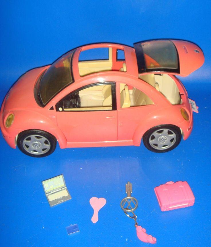 Coche de Barbie rosa con accesorios