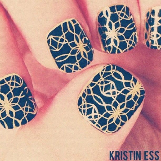 Black gel nails with gold lace Minx over the top. [via @kristin_ess