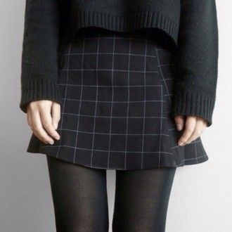 black sweater and grid skirt