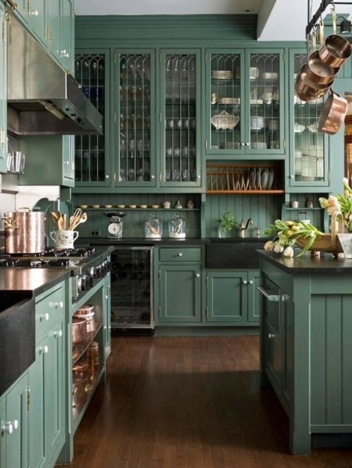 Teal kitchen with black accents and glass cabinet doors