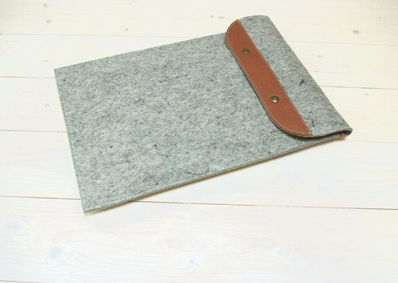 Safe and classic. Premium materials for our fold over 13 inch laptop case in grey felt and cognac brown leather.  For sale on Etsy and our website westerman bags dot com