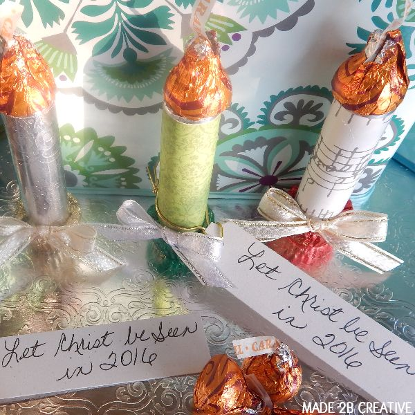 Lifesaver Candy Candle Craft made with breath mint rolls, candy Kisses, and mini Reese's Peanut Butter Cups.