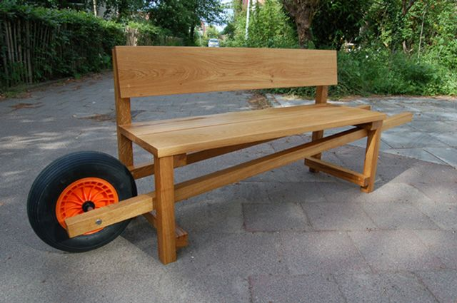 Keep your patio or garden space urban by creating your own wheelbarrow bench. Adhering to the traditional wheelbarrow make, this bench features adorable handles and a wheel at the end to resemble an actual wheelbarrow. Not only is this a unique, fun idea, but if you ever need to move the bench, it's as easy as lifting and wheeling away!