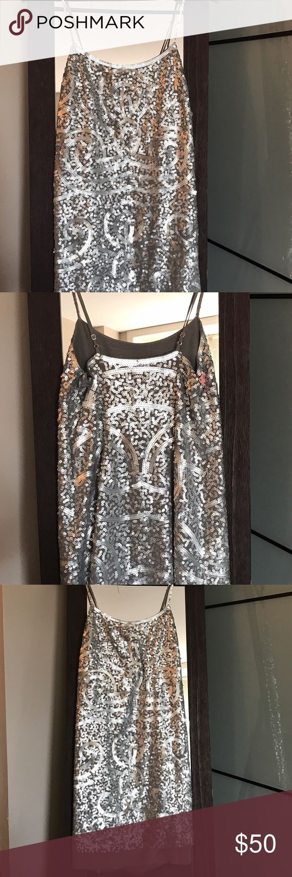 BCBG MAXAZRIA silver cocktail dress Great condition - wore once for NYE and then dry cleaned. Zipper at side. Adjustable spaghetti straps. BCBGMaxAzria Dresses Mini