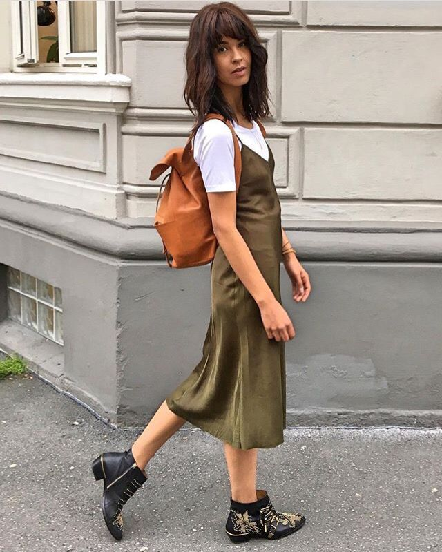 Green dress and white top paired with ankle boots and orange backpack. Taken from Maria Mena's Twitter #summer